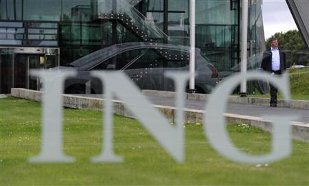 A man walks near a signage of ING at the headquarters in Amsterdam July 16, 2012. REUTERS/Robin van Lonkhuijsen/United Photos
