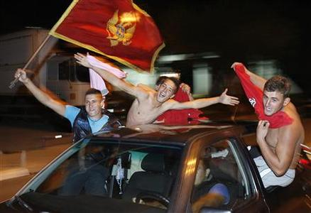 Supporters of the Democratic Party of Socialists (DPS) celebrate after Montenegro's parliamentary elections in Podgorica, October 14, 2012. REUTERS/Stevo Vasiljevic