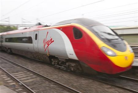 A Virgin train travels towards Euston rail station in London August 15, 2012. REUTERS/Neil Hall
