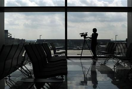 A member of the media stands inside the newly built A-Plus terminal section at the Fraport airport during a guided media tour in Frankfurt September 28, 2012. REUTERS/Lisi Niesner