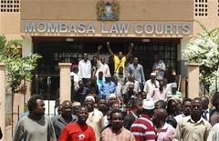 Members of the banned Mombasa Republican Concil (MRC) group gather outside the Mombasa Law Courts in the Kenyan coastal city of Mombasa April 24, 2012. REUTERS/Peter Imbote