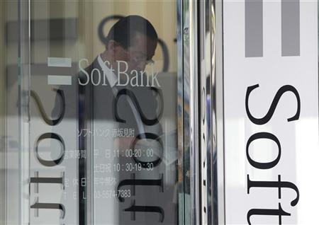 A customer looks through a brochure inside a Softbank Corp branch in Tokyo October 15, 2012. REUTERS/Yuriko Nakao/Files