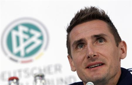 Miroslav Klose of Germany's national soccer team addresses a news conference in Berlin, October 15, 2012. Germany will play a World Cup 2014 Group C qualifying match against Sweden in the German capital tomorrow. REUTERS/Tobias Schwarz