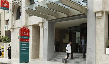 A guest enters the lobby of the Ibis hotel, in Mohamed V avenue, in Tunisia April 3, 2012. REUTERS/Zoubeir Souissi
