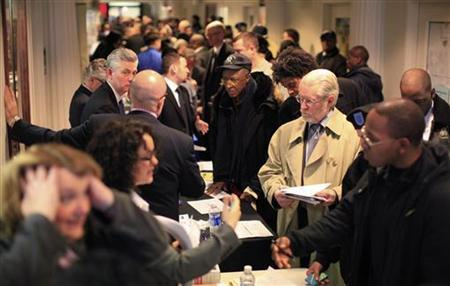 People attend a military veterans hiring event in New York January 19, 2012. REUTERS/Brendan McDermid