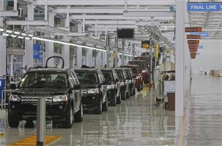 Jaguar Land Rover Freelander 2 vehicles are displayed on the production line for the media at their production plant in Pune, 190km (118 miles) south of Mumbai, May 27, 2011. REUTERS/Danish Siddiqui/Files