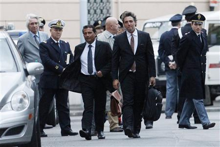 The captain of the Costa Concordia Francesco Schettino (3rd L) leaves the Moderno Theatre after a pre-trial hearing for the cruise liner Costa Concordia disaster in Grosseto October 15, 2012. REUTERS/Giampiero Sposito
