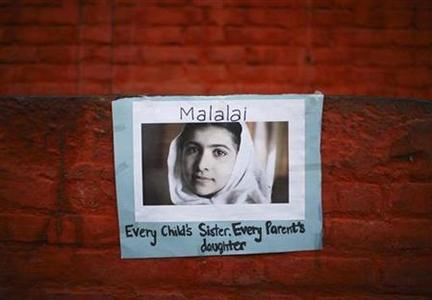 A portrait of Pakistani schoolgirl Malala Yousufzai is pictured during a candlelight vigil organized by Nepalese Youth in Kathmandu October 15, 2012. REUTERS/Navesh Chitrakar