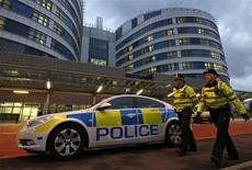"""Police officers patrol outside the emergency entrance of the Queen Elizabeth Hospital where injured Pakistani teenager Malala Yousufzai arrived for treatment in Birmingham, central England October 15, 2012. A Pakistani schoolgirl shot in the head by the Taliban has every chance of making a """"good recovery"""", British doctors said on Monday. REUTERS/Chris Helgren"""