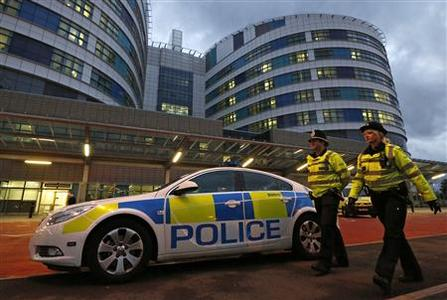 Police officers patrol outside the emergency entrance of the Queen Elizabeth Hospital where injured Pakistani teenager Malala Yousufzai arrived for treatment in Birmingham, central England October 15, 2012. A Pakistani schoolgirl shot in the head by the Taliban has every chance of making a ''good recovery'', British doctors said on Monday. REUTERS/Chris Helgren