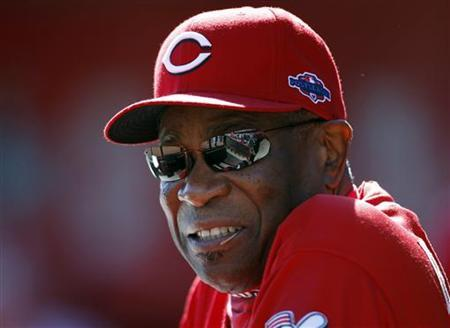 Cincinnati Reds manager Dusty Baker watches from the dugout as his team plays the San Francisco Giants in Game 5 of their MLB NLDS playoff baseball series in Cincinnati, Ohio October 11, 2012. REUTERS/Jeff Haynes