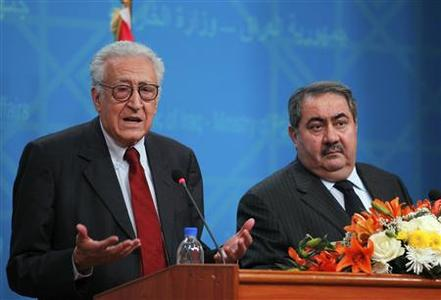 UN-Arab League peace envoy for Syria Lakhdar Brahimi (L) speaks to the media during a joint news conference with Iraq's Foreign Minister Hoshyar Zebari at the Foreign Ministry in Baghdad October 15, 2012. REUTERS/Mohammed Ameen (IRAQ - Tags: POLITICS)