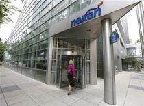 A woman walks into the Nexen building in downtown Calgary, Alberta, July 23, 2012. REUTERS/Todd Korol