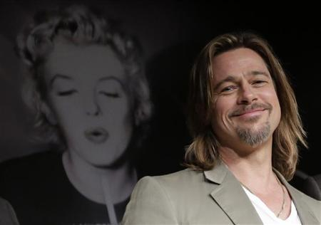 Cast member Brad Pitt attends a news conference for the film ''Killing Them Softly'', in competition at the 65th Cannes Film Festival May 22, 2012. REUTERS/Eric Gaillard