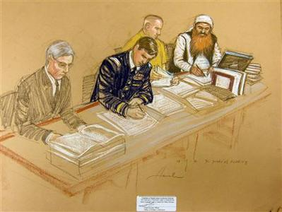 Khalid Sheikh Mohammed (R), sits with his defence team in this artist's sketch during a pre-trail hearing at the U.S. Naval Base Guantanamo Bay, Cuba, October 15, 2012. REUTERS/Janet Hamlin