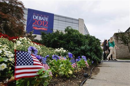 Small American flags stand in a flower bed as preparations continue for Tuesday's presidential debate at Hofstra University in Hempstead, New York, October 15, 2012. REUTERS/Lucas Jackson