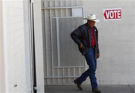 A voter exits a polling station after voting in Phoenix, Arizona February 28, 2012. REUTERS/Joshua Lott