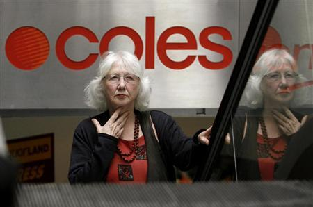 A customer leaves a Coles store in central Sydney April 17, 2008. REUTERS/Daniel Munoz