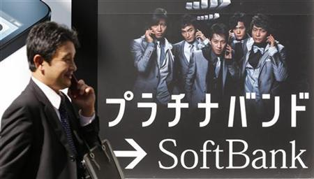 A man walks past a Softbank advertisement board at its shop in Tokyo October 16, 2012. REUTERS/Kim Kyung-Hoon/Files