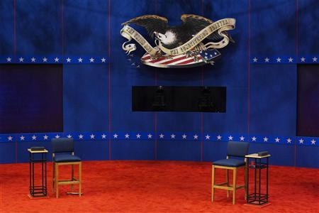 Two chairs that will be used by U.S. President Barack Obama and Republican presidential nominee Mitt Romney sit empty during preparations for Tuesday's presidential debate at Hofstra University in Hempstead, New York, October 15, 2012. REUTERS/Lucas Jackson