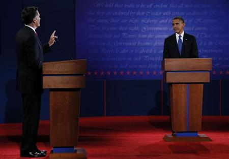 Republican presidential nominee Mitt Romney answers a question as U.S. President Barack Obama listens during the first presidential debate in Denver October 3, 2012. REUTERS/Jim Bourg