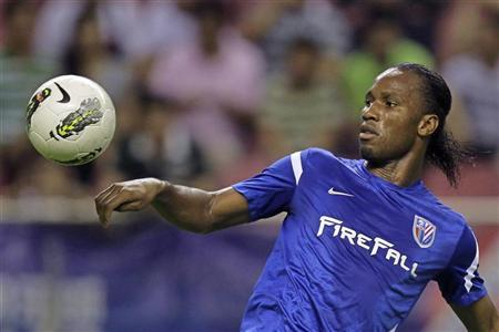 Shanghai Shenhua's striker Didier Drogba controls the ball during the Chinese Super League match against Hangzhou green town at the Shanghai Hongkou Stadium in Shanghai August 4, 2012. REUTERS/Aly Song