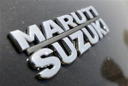 The brand name of Maruti Suzuki is pictured on a Swift car at the company's stock yard in the western Indian city of Ahmedabad April 25, 2011. REUTERS/Amit Dave