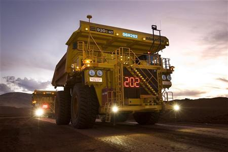 Remotely controlled tipper trucks operate at a Rio Tinto iron ore mine in Western Australia in this undated handout picture made available March 26, 2012. REUTERS/Rio Tinto/Handout