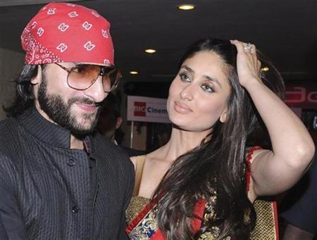 Bollywood actors Saif Ali Khan (L) and Kareena Kapoor arrive at the premiere of film ''3 Idiots'' in Mumbai December 23, 2009. REUTERS/Manav Manglani/Files