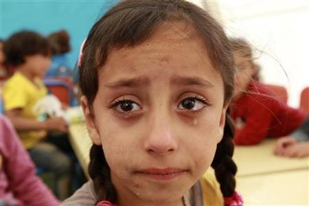 A Syrian child refugee cries during the fourth day of school at Al Zaatri refugee camp, in the Jordanian city of Mafraq, near the border with Syria October 4, 2012. REUTERS/Muhammad Hamed
