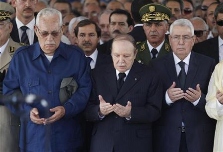 Algeria's President Abdelaziz Bouteflika (C), Algerian former president Ali Kafi (L) and Abdelkader Bensalah, President of the Council of Nation, pray during the funeral ceremony of former Algerian President Chadli Bendjedid at Al Alia Cemetery in Algiers October 8, 2012. REUTERS/Louafi Larbi