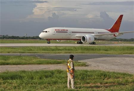 A security personnel stands guard as Air India's Dreamliner Boeing 787 taxies upon its arrival at the airport in New Delhi September 8, 2012. AREUTERS/Mansi Thapliyal