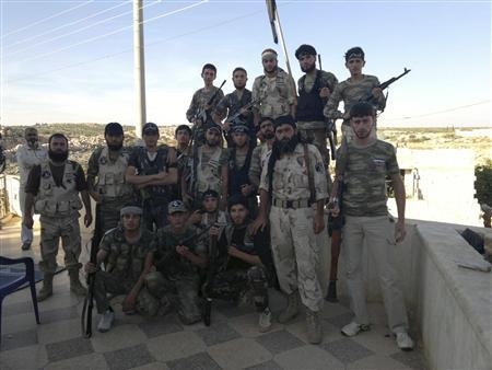 Free Syrian Army fighters are seen at Sermada near Idlib October 13, 2012. Picture taken October 13, 2012. REUTERS/Shaam News Network/Handout