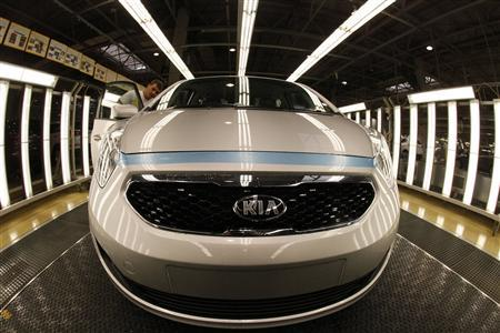 A worker checks the interior of a Kia car in its factory in Zilina, 200 kilometres north of Bratislava October 3, 2012. REUTERS/Petr Josek
