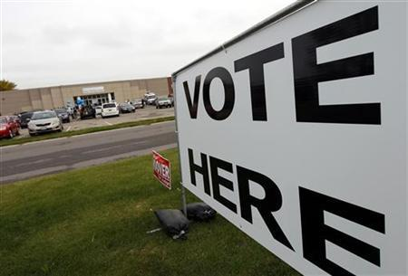 Voters arrive to cast their ballots at a Franklin County polling location on the first day of in-person absentee voting in Columbus, Ohio October 2, 2012. REUTERS/Matt Sullivan