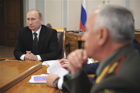 Russian President Vladimir Putin (L) chairs a meeting on terrorism countermeasures at the Novo-Ogaryovo residence outside Moscow October 16, 2012. REUTERS/Alexsey Druginyn/RIA Novosti/Pool