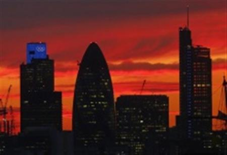 A sunset is seen behind the city of London July 30, 2012. REUTERS/Eddie Keogh