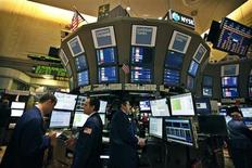 Traders work at the Goldman Sachs kiosk before the opening bell on the floor of the New York Stock Exchange, October 16, 2012. REUTERS/Brendan McDermid