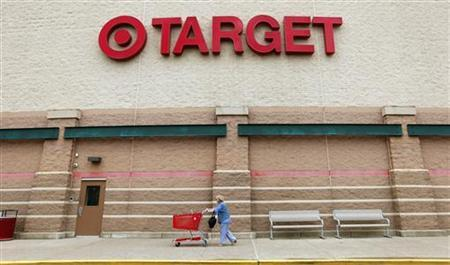 A Target shopper pushes her card outside a store in Falls Church, Virginia May 14, 2012. REUTERS/Kevin Lamarque