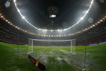 Rain puddles cover the pitch before the World Cup 2014 qualifying match between England and Poland at the National Stadium in Warsaw, October 16, 2012. REUTERS/Darren Staples