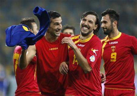 Montenegro's Dejan Damjanovic (2nd R) celebrates with teammates after winning the 2014 World Cup qualifying soccer match against Ukraine at the Olympic Stadium in Kiev October 16, 2012. REUTERS/Anatolii Stepanov