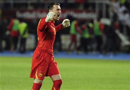 Macedonian goalkeeper Tome Pacovski celebrates a goal against Serbia during their 2014 World Cup qualifying soccer match in Skopje October 16, 2012. REUTERS/Ognen Teofilovski