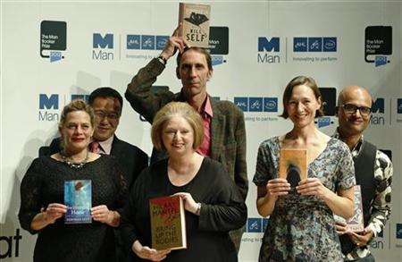 Man Booker Prize shortlisted authors (L - R) Deborah Levy, author of Swimming Home, Tan Twan Eng, author of The Garden of Evening Mists, Hilary Mantel, author of Bring up the Bodies, Will Self, author of Umbrella, Alison Moore, author of The Lighthouse and Jeet Thayil, author of Narcopolis, pose for photographers during a event in London October 15, 2012. REUTERS/Luke MacGregor
