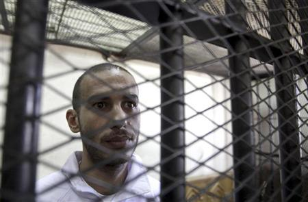 Computer science graduate Alber Saber, 27, is seen inside the cage during his trial in Cairo September 26, 2012. REUTERS/Mohamed Abd El Ghany