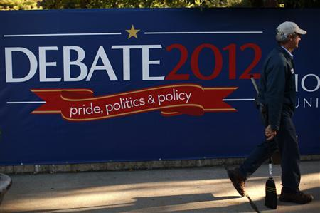 A worker walks past a sign outside the site of the second U.S. presidential campaign debate in Hempstead, New York, October 16, 2012. REUTERS/Jim Young