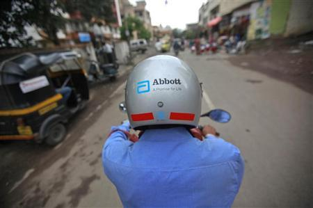 A representative for Abbott rides his bike to a doctor's clinic in Pune August 27, 2012. Picture taken August 27, 2012. REUTERS/Danish Siddiqui