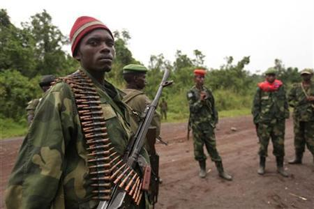 M23 rebel fighters occupy Rumangabo, after government troops abandoned the town, 23km north of the eastern Congolese city of Goma, July 28, 2012. REUTERS/James Akena/Files
