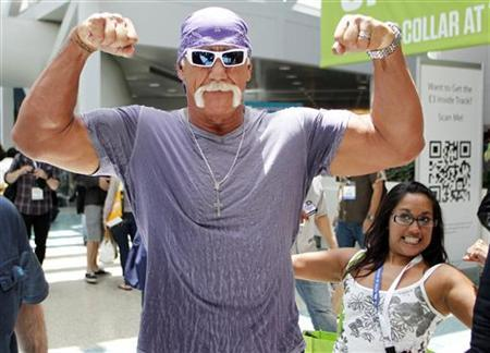 Wrestler Hulk Hogan poses for a photo as a fan also poses as he walks in the Los Angeles Convention Center while on site to promote Majesco Entertainment's ''Hulk Hogan's Main Event'' video game on Kinect for Xbox 360 during the Electronic Entertainment Expo or E3 in Los Angeles June 7, 2011. REUTERS/Danny Moloshok/Files