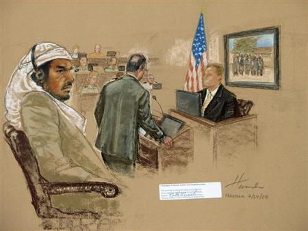 In this file photograph of a sketch by courtroom artist Janet Hamlin, reviewed by the U.S. Military, defendant Salim Hamdan sits during his trial inside the war crimes courthouse at Camp Justice, the legal complex of the U.S. Military Commissions, at Guantanamo Bay U.S. Naval Base, in Cuba, July 24, 2008. REUTERS/Janet Hamlin/Pool