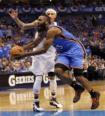 Oklahoma City Thunder guard James Harden (R) drives on Dallas Mavericks guard Delonte West during the second half of their NBA Western Conference quarter-final playoff basketball game in Dallas, Texas May 5, 2012. REUTERS/Mike Stone